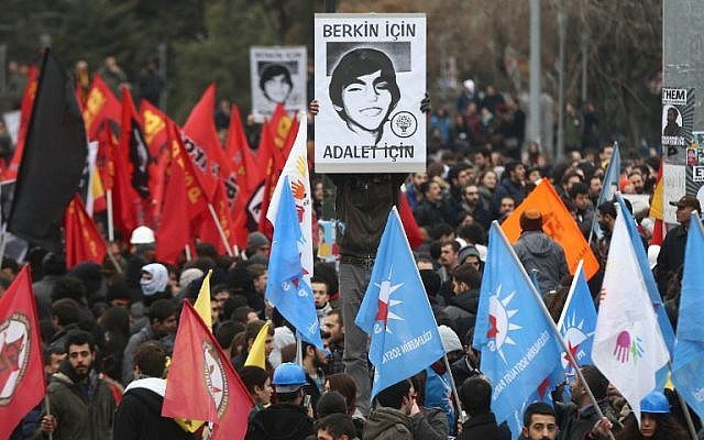 A protester holds a placard displaying a portrait of Berkin Elvan, reading 'We want justice for Berkin Elvan,' after the announcement of the death of the teenager on March 11, 2014, in Ankara. (photo credit: AFP/Adem Altan)