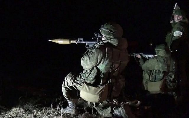 Russian paratroopers taking part in a night drill near the Ukrainian border, March 13, 2014 (Photo credit: Andrey Kronberg/AFP)