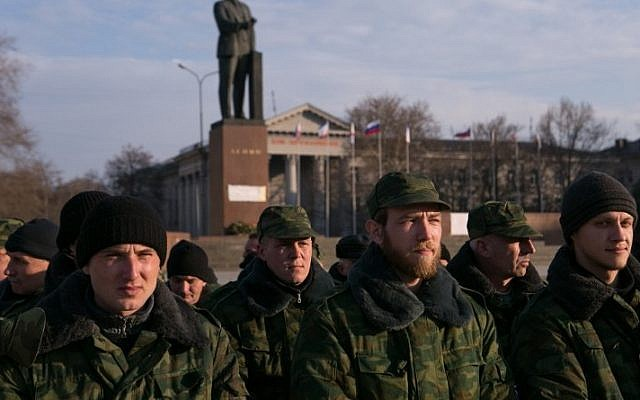 Pro-Russian volunteers gather in a square next to the Council of Ministers of Crimea's building, in Simferopol, on March 14, 2014 (photo credit: AFP/Daniel Leal Olivas)