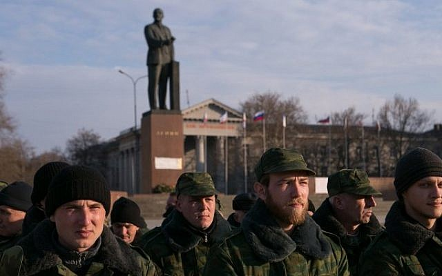 Pro-Russian volunteers gather at Lenin Square in Simferopol, Crimea, on March 14, 2014 (photo credit: AFP/Daniel Leal Olivas)