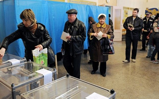 People cast their votes at a polling station on March 16, 2014 in Simferopol, Crimea, over a referendum on breaking away from Ukraine and re-joining Russia. (photo credit: AFP Photo/Viktor Drachev)
