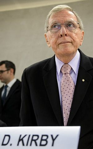 Chairperson of the UN Commission of Inquiry (COI) on Human Rights in North Korea, retired Australian judge Michael Kirby, arrives to take part in an UN Human Rights Council on March 17, 2014 in Geneva. (photo credit: AFP/Fabrice Coffrini)