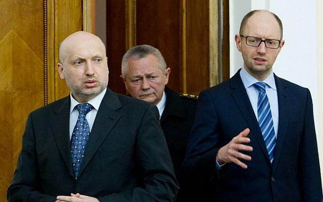 Ukrainian Prime Minister Arseniy Yatsenyuk (right), interim Ukrainian president Olexander Turchynov (left) and Defence Minister Igor Tenyukh (center) on March 18, 2014, in Kiev. (photo credit: AFP/UKRAINIAN PRESIDENTIAL PRESS SERVICE/MYKHAYLO MARKIV)