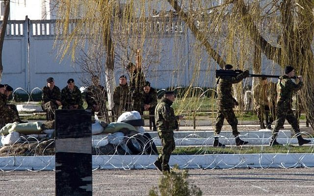 Ukrainian soldiers load weapons and amunition into trucks at the Ukrainian marine battalion in the Crimean city of Feodosia on March 23, 2014. (photo credit: AFP/Dmitry Serebryakov)
