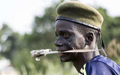 A fighter in the war-torn Central African Republic. (photo credit: AFP/ FRED DUFOUR)