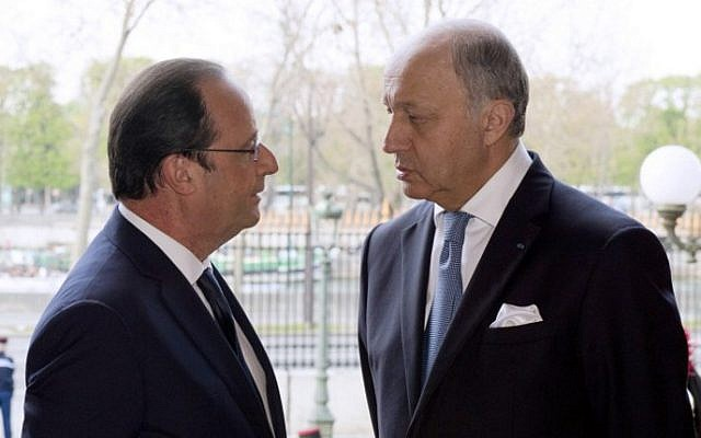 French President Francois Hollande (left) talks with French Minister of Foreign Affairs Laurent Fabius on March 27, 2014. (photo credit: AFP/ALAIN JOCARD)