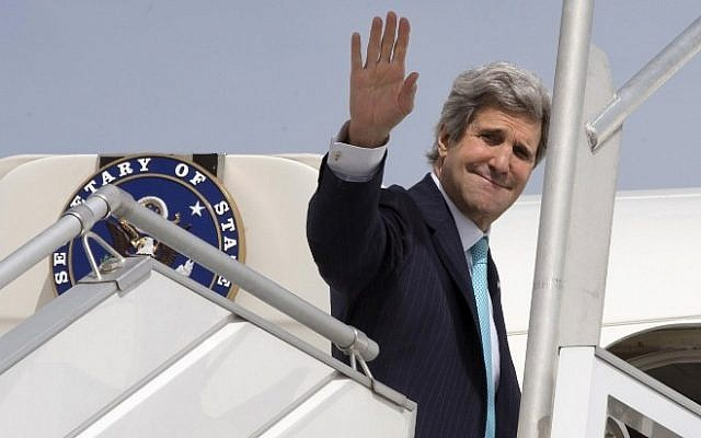 US Secretary of State John Kerry waves as he boards a plane in Paris, France, on March 31, 2014 (photo credit: AFP/pool/Jacquelyn Martin)