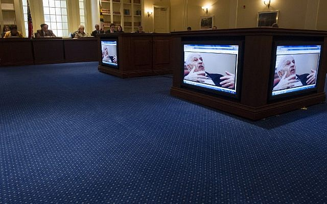 The Maryland House Ways and Means Committee watches a video of late Holocaust survivor Leo Bretholz, who died March 8, 2014 just days before he was due to testify on a Holocaust reparations bill in Annapolis, MD, March 10, 2013 (photo credit: AFP/Jim Watson)