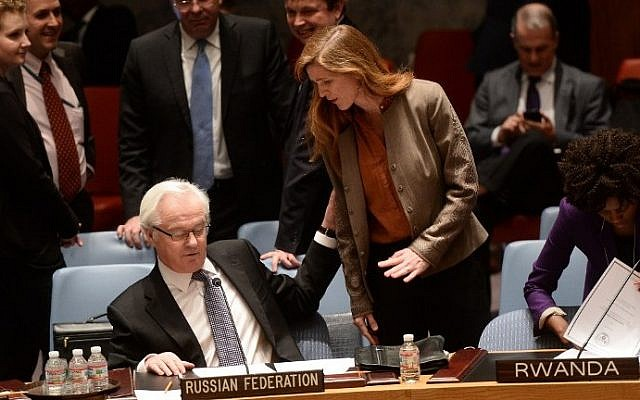 US Ambassador to the UN Samantha Power talks with her Russian counterpart Vitaly Churkin prior to a vote on a resolution on Ukraine during a United Nations Security Council emergency meeting at UN headquarters in New York on March 15, 2014. (photo credit: AFP/Emmanuel Dunand)