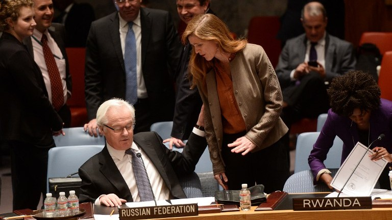 US Ambassador to the UN Samantha Power talks with her Russian counterpart Vitaly Churkin prior to a vote on a resolution on Ukraine during a UN Security Council emergency meeting at United Nations headquarters in New York on March 15, 2014. (photo credit: AFP/Emmanuel Dunand)