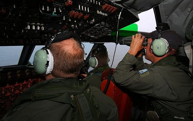 RAAF flight crew keep watch for debris from a AP-3C Orion during a search mission for missing Malaysia Airline flight MH370 in the Southern Indian Ocean on March 26, 2014.  (photo credit: AFP/ Paul KANE)