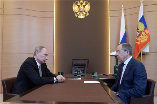 Russian President Vladimir Putin, left listens to Foreign Minister Sergey Lavrov, right, during their meeting at the Bocharov Ruchei residence in Sochi, southern Russia, Monday, March 10, 2014.  (photo credit: ap/RIA-Novosti, Alexei Nikolsky, Presidential Press Service)