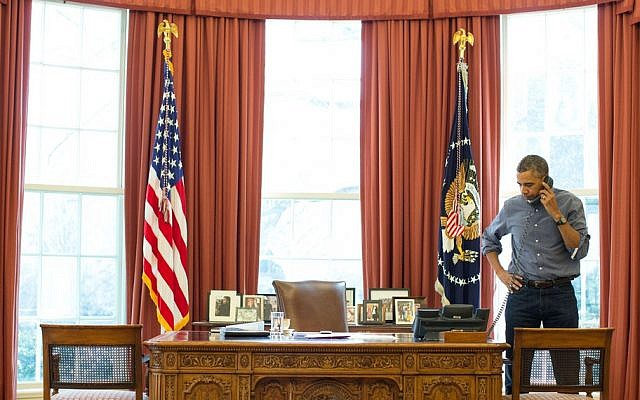 US President Barack Obama talks on the phone in the Oval Office with Russian President Vladimir Putin about the situation in Ukraine, Saturday, March 1, 2014 (photo credit: Pete Souza/White House/Flickr )