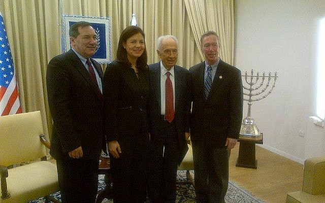 President Shimon Peres meets with Senator Kelly Ayotte (R-NH), Senator Joe Donnelly (D-IN), left, and Congressman Stephen Lynch (D-MA), right) in Jerusalem on March 20, 2014. (photo credit: Ambassador Dan Shapiro, Facebook)