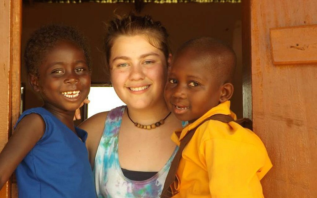 Jessica Baer in Ghana with two of the former child slaves rescued by Breaking the Chain through Education. (Courtesy of Michael Baer/JTA)