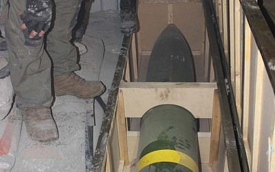 IDF soldiers inspect a missile found on board the Klos-C in a commando operation on Wednesday, March 5, 2014. The military says the ship was carrying an Iranian arms shipment headed for Gaza. (IDF)