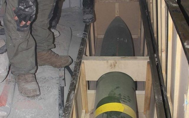 IDF soldiers inspect a missile found on board the Klos-C in a commando operation on Wednesday, March 5, 2014. The military said the ship was carrying an Iranian arms shipment headed for Gaza. (IDF)