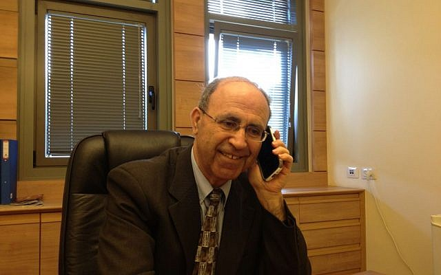 Hadash MK Hanna Swaid at his Knesset office, March 10, 2014 (photo credit: Elhanan Miller/Times of Israel)