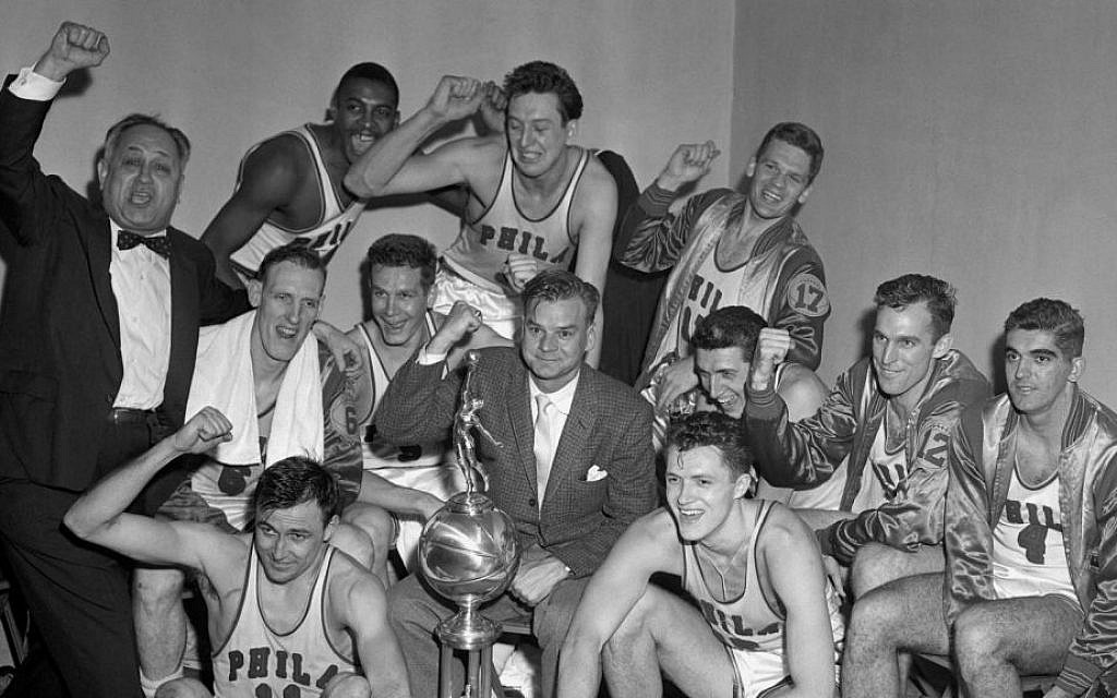 Owner Eddie Gottlieb, left, celebrating the Philadelphia Warriors winning the 1955-56 NBA championship. (Courtesy NBA Photos/JTA)