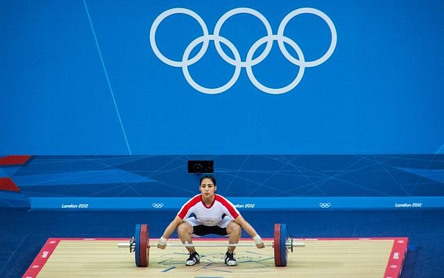 A weightlifter participates in the women's 75 kg event in the London 2012 Summer Olympics. Israel is set to host its first European weightlifting championship in April 2014. (illustrative photo credit: CC BY Simon Q/Flickr)