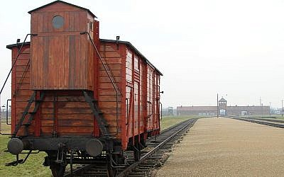An original railway carriage stands at the Judenrampe platform at Auschwitz (Adam Jones/Wikimedia Commons)