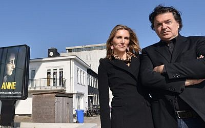 """ANNE"" co-writers Leon de Winter and Jessica Durlacher stand outside the Amsterdam theater that is being built as a venue for their play on March 12, 2014. (photo credit: Cnaan Liphshiz/JTA)"