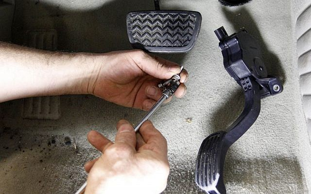 In this Feb. 8, 2010, photo, a modified accelerator pedal from a Toyota 2007 Hybrid Camry is replaced at Jack Taylor's Alexandria Toyota-Scion in Alexandria, Va.  (photo credit: AP Photo/Alex Brandon, File)