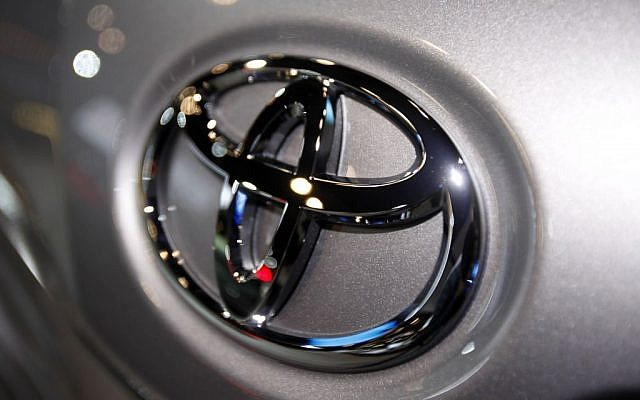 In this March 31, 2010 file photo, the Toyota logo is seen on a car displayed at the New York International Auto Show in New York. (photo credit: AP Photo/Seth Wenig, File)