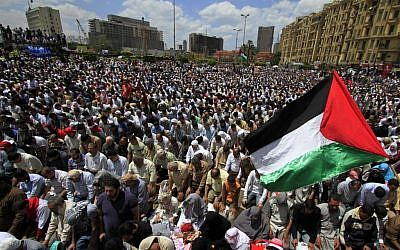 Egyptians wave Palestinian flags during Friday prayers at an anti-Israel rally in Cairo's Tahrir Square, May 13, 2011 (photo credit: AP/Khalil Hamra)