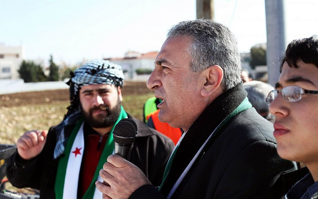 In this Friday, Jan. 6, 2012 photo, Kamal al-Labwani, 54, speaks to a crowd during an anti-Assad rally in Amman, Jordan (photo credit: AP/Mohammad Hannon)