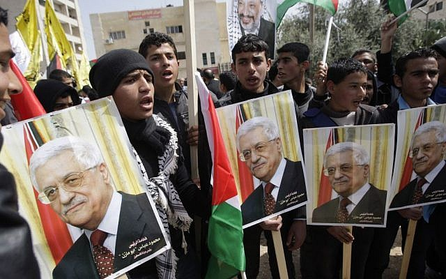 Palestinians in the West Bank town of Toubas shout slogans in support of Palestinian President Mahmoud Abbas ahead of his meeting with U.S. President Barack Obama, March 16, 2014 (Photo credit: Mohammed Ballas/AP)