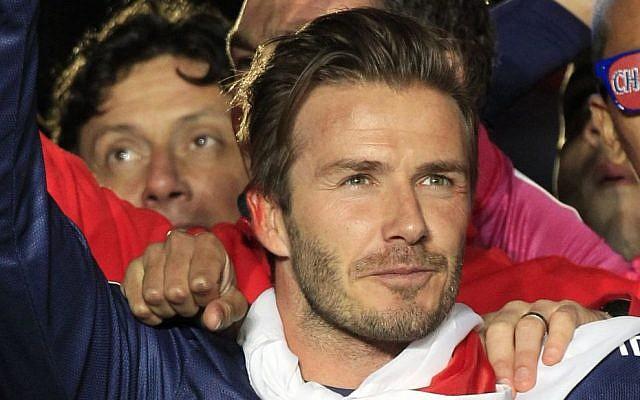David Beckham celebrates Paris Saint-Germain's French League One title, at the Parc des Princes stadium, in Paris, Saturday, May 18, 2013. This match was his final home game for Paris Saint-Germain before retirement. (photo credit: AP Photo/Thibault Camus)