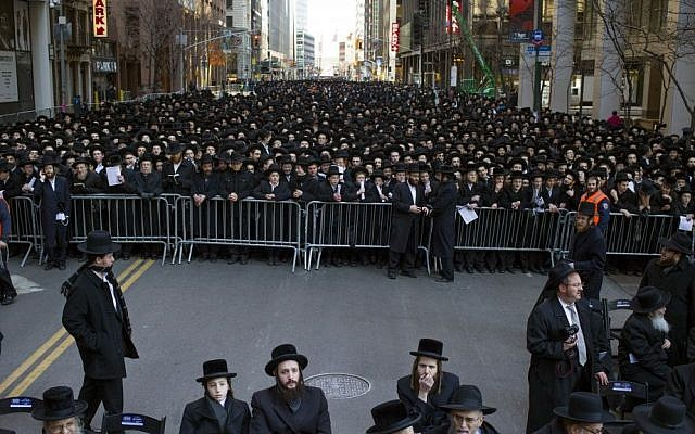 Thousands of ultra-Orthodox Jews gather in New York, Sunday, March 9, 2014, to protest against the proposed conscription law in Israel (photo credit: AP/Craig Ruttle)
