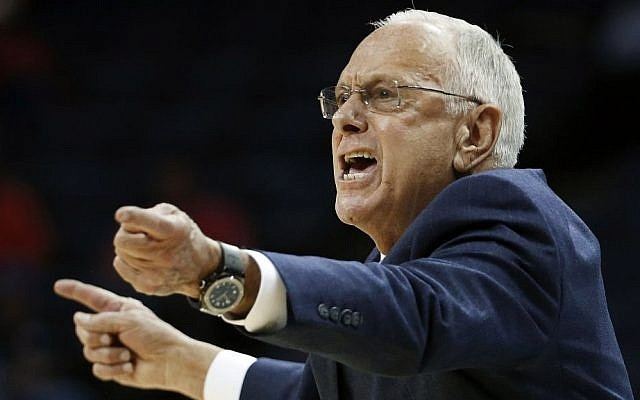 Southern Methodist University head coach Larry Brown directs his players in the first half of an NCAA college basketball game against Houston at the American Athletic Conference tournament Thursday, March 13, 2014, in Memphis, Tennessee (photo credit: AP/Mark Humphrey)