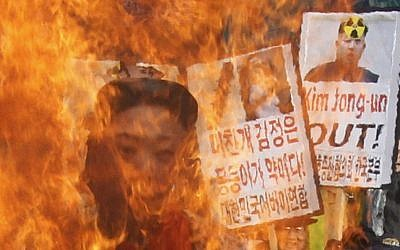 South Korean protesters burn an effigy of North Korean leader Kim Jong Un during an anti-North Korea rally to denounce North Korea's nuclear test in February 2013.  (photo credit:AP Photo/Ahn Young-joon, File)