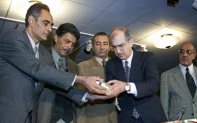 Egypt and US officials display the flight data recorder from EgyptAir Flight 990, Wednesday Nov. 10, 1999 at the National Transportation Safety Board in Washington. (photo credit: AP/Doug Mills)