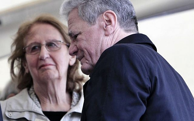 German President Joachim Gauck, right, passes Greek President's wife May Panou during a ceremony for dozens of villagers massacred by German army troops in 1943, in retaliation for the killing of a German officer by partisans, at the village of Ligiades in northwestern Greece, on Friday, March 7, 2014. (AP Photo/Thanassis Stavrakis)