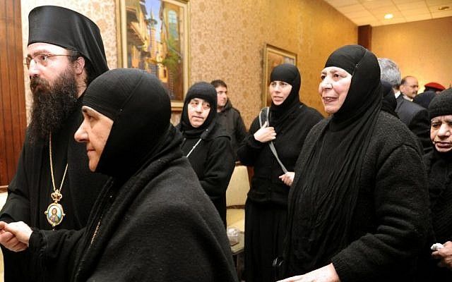 A group of nuns who were freed after being held by rebels greet church officials at the Syrian border town of Jdeidat Yabous, early Monday, March 10, 2014 (Photo credit: AP/SANA)