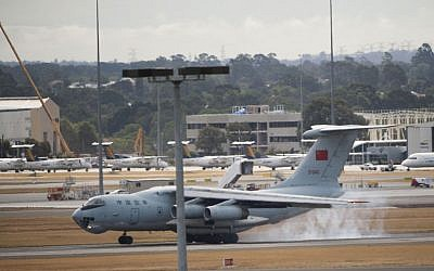 A Chinese IL-76 plane searching for the missing Malaysia Airlines Flight MH370 lands at Perth airport, Australia, after a hunting sortie Monday, March 24, 2014.  (AP/Xinhua, Lui Siu Wai)