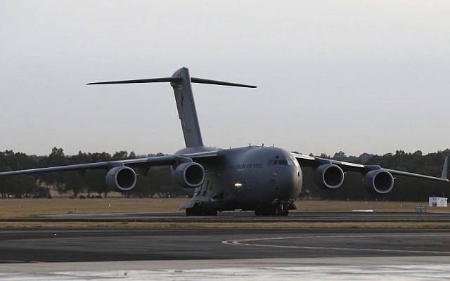 Royal Australia Air Force C-17 lands at RAAF Base Pearce to deliver a Sea Hawk helicopter to help with the search for missing Malaysia Airlines Flight MH370, in Perth, Australia, Friday (photo credit: AP/Rob Griffith)