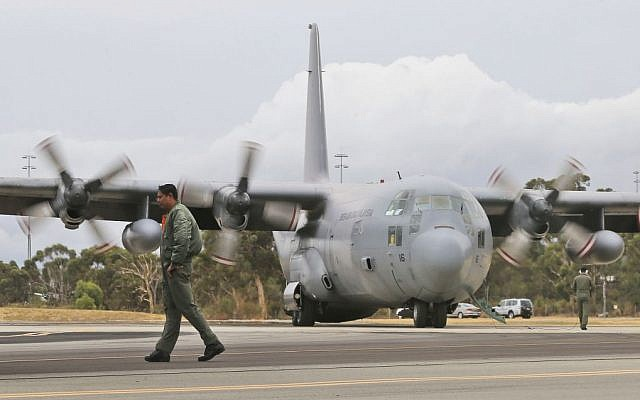 A Royal Malaysian Air Force C-130 Hercules taxies along the tarmac at RAAF Base Pearce to to help with the search for debris or wreckage of the missing Malaysia Airlines Flight MH370 in Perth, Australia, Saturday, March 29, 2014. (photo credit: AP/Rob Griffith)