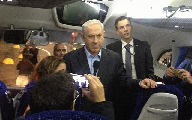 Prime Minister Benjamin Netanyahu on board a tour bus carrying foreign journalists after his address to the press in Eilat, Monday, March 3, 2014 (photo credit: Mitch Ginsburg/Times of Israel)