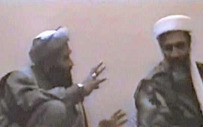 In this undated photo, Sulaiman Abu Ghaith, left, gestures toward al-Qaeda founder Osama Bin Laden, somewhere in Afghanistan (photo credit: AP/US Attorney's Office for the Southern District of New York)