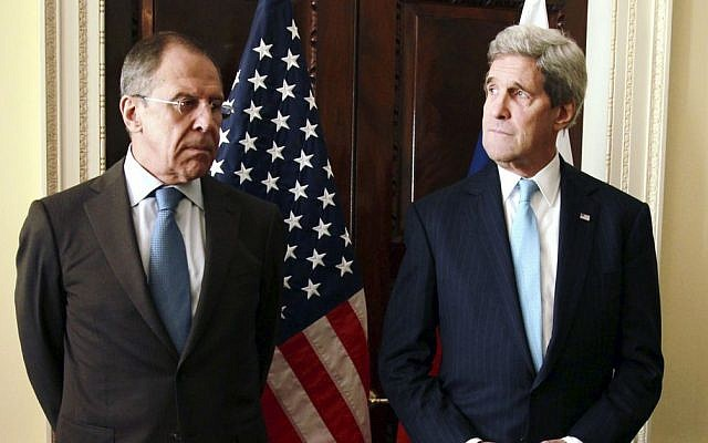 Russian Foreign Minister Sergey Lavrov, left, and US Secretary of State John Kerry stand together prior to a meeting at Winfield House in London, Friday March 14, 2014 (photo credit: AP/Sean Dempsey/Pool)
