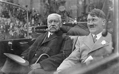 Paul von Hindenburg, left, and Adolf Hitler ride in an open car during a parade in Berlin, Germany, May 1933 (photo credit: unknown/German Federal Archive)