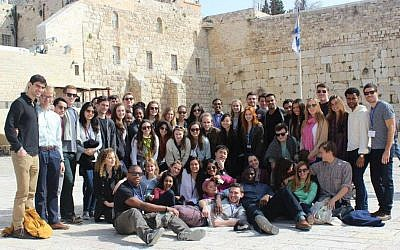 The CJP will continue as a willing and enthusiastic sponsor of the Harvard Student Israel Trek. Trek participants posing at the Western Wall, March 2014. (Photo: Zachary Hodges)
