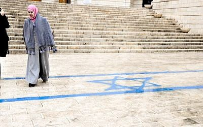 An Israeli flag was painted outside the courthouse. Walking over national or religious symbols is a sign of disrespect in Arab culture and in Muslim tradition, which requires the faithful to be barefoot when praying. (photo credit: Michal Shmulovich)