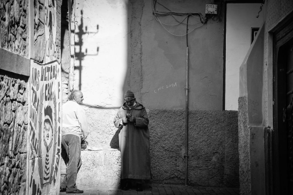 A man wears a djellaba, a traditional Moroccan hooded cape for men or women, in the old mellah of Marrakech. (photo credit: Michal Shmulovich)