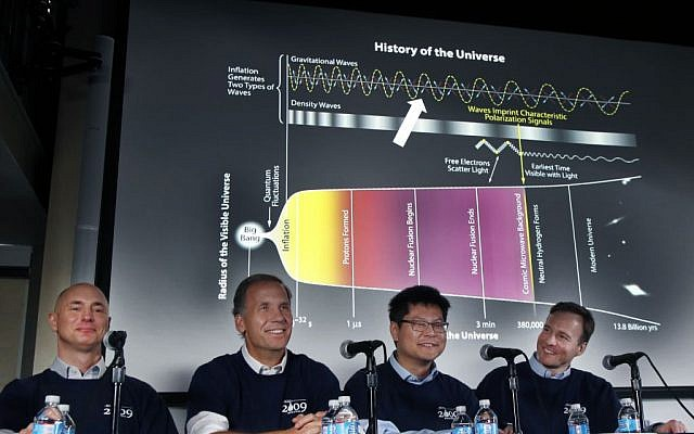 Scientists, from left, Clem Pryke, Jamie Bock, Chao-Lin Kuo and John Kovac smile during a news conference at the Harvard-Smithsonian Center for Astrophysics in Cambridge, Mass., Monday, March 17, 2014, regarding their new findings on the early expansion of the universe. Scientists say that the universe was born almost 14 billion years ago, exploding into existence in an event called the Big Bang. Now these researchers say they've spotted evidence that a split-second later, the expansion of the cosmos got a powerful-jump start. Experts called the discovery a major advance if confirmed. (photo credit: AP Photo/Elise Amendola)