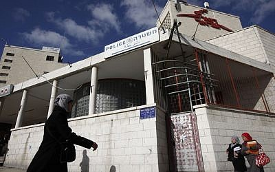 Palestinians walk by the post office and police station on Salahadin street in East Jerusalem, adjacent to a soon to be inaugurated yeshiva (photo credit: Miriam Alster/Flash90)